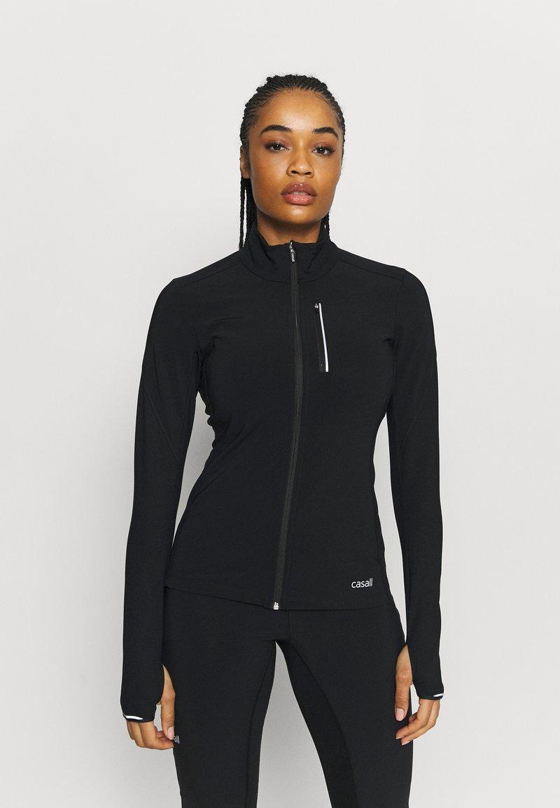 Casall - WINDTHERM JACKET - Sports jacket - black