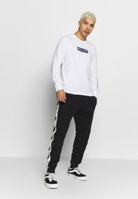 Hollister Co. - Tracksuit bottoms - black - 1