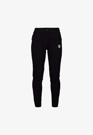COMFY PERFORMANCE  - Tracksuit bottoms - schwarz