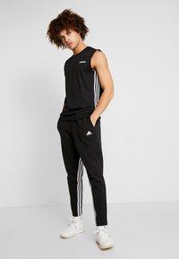 adidas Performance - Verryttelyhousut - black/white - 1
