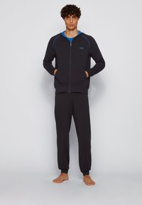 BOSS - Tracksuit bottoms - black - 1