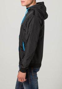 Urban Classics - Light jacket - black/turquoise - 3