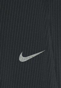 Nike Performance - SWIFT - Leggings - black - 5