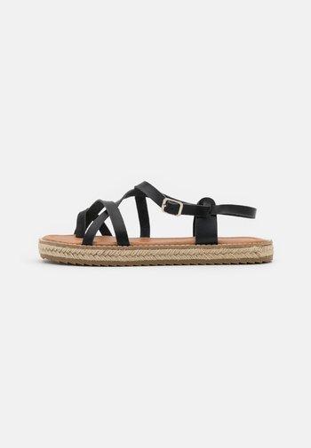 ALTHEA - T-bar sandals - black