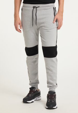 Pantalones deportivos - hellgrau schwarz