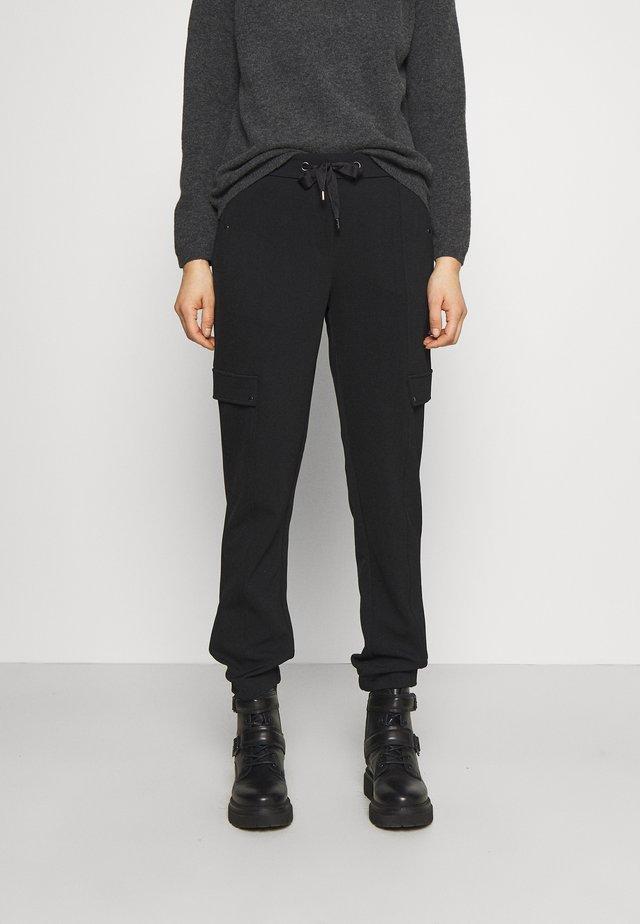 HOSE - Pantalones deportivos - black