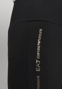EA7 Emporio Armani - Leggings - Trousers - black - 3