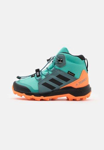 TERREX MID GTX UNISEX - Hiking shoes - acid mint/core black/screaming orange