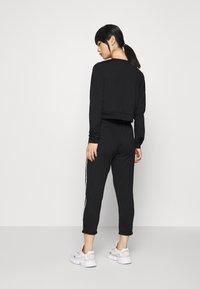 ONLY PLAY Petite - ONPADOR PANTS  - Pantalones deportivos - black - 2