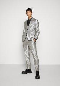 HUGO - GERMAN - Suit trousers - natural - 1