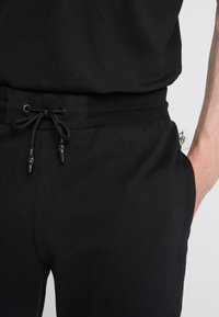 Plein Sport - JOGGING TROUSERS STATEMENT - Pantaloni sportivi - black - 3