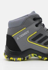 adidas Performance - TERREX HYPERHIKER TRAXION HIKING SHOES UNISEX - Hiking shoes - grey four/core black/grey three - 5