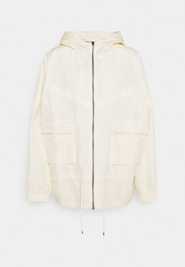 W NSW ICN CLSH JKT WR CANVAS - Training jacket - coconut milk/pale vanilla