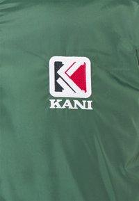 Karl Kani - UNISEX RETRO REVERSIBLE PUFFER JACKET - Winter jacket - dark red - 4