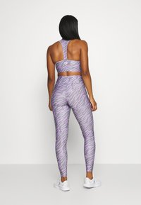 Pink Soda - ZEBRA TIGHT - Leggings - lilac - 2