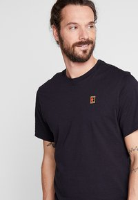 Nike Performance - COURT TEE - Basic T-shirt - black - 3