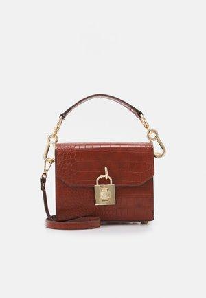 BPURE CROSSBODY BAG - Across body bag - cognac