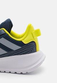 adidas Performance - TENSAUR RUN UNISEX - Neutral running shoes - crew navy/halo silver/acid yellow - 5