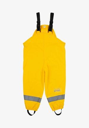 REGENTRÄGER - Rain trousers - gelb