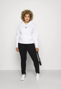 Tommy Hilfiger Curve - SCULPT PANT - Jeans Skinny Fit - black - 1