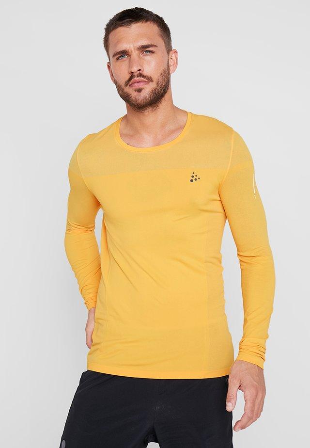 URBAN RUN LIGHT  - T-shirt sportiva - buzz