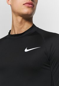 Nike Performance - PRO TIGHT MOCK - Sports shirt - black/white - 4