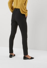 Next - SLIM TROUSERS - Trousers - black - 3