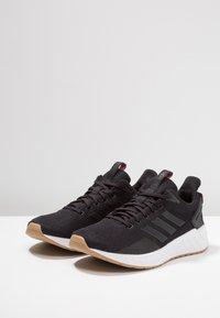 adidas Performance - QUESTAR RIDE - Juoksukenkä/neutraalit - core black/grey five - 2