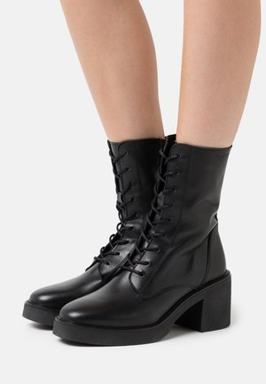 KANDY - Platform ankle boots - black