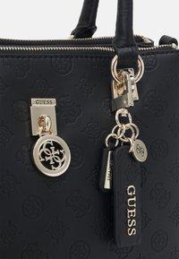 Guess - NINNETTE STATUS SATCHEL - Handbag - black - 3