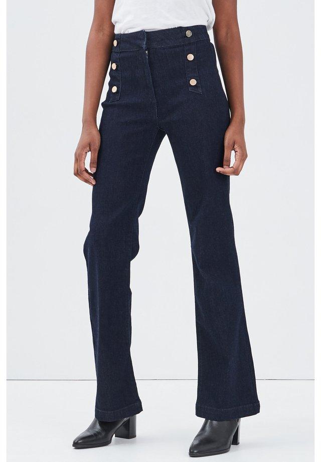 MIT STEG - Bootcut jeans - denim brut