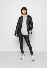 Monki - FRIDA SHINY - Leggings - Trousers - black dark - 1