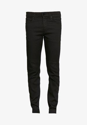 058 SLIM TAPER - Slim fit jeans - black