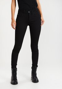 G-Star - LYNN MID SUPER SKINNY  - Jeans Skinny Fit - yield black ultimate stretch denim - 0