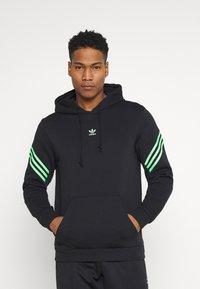 adidas Originals - SWAROVSKI HOODIE UNISEX - Luvtröja - black/shock lime - 0