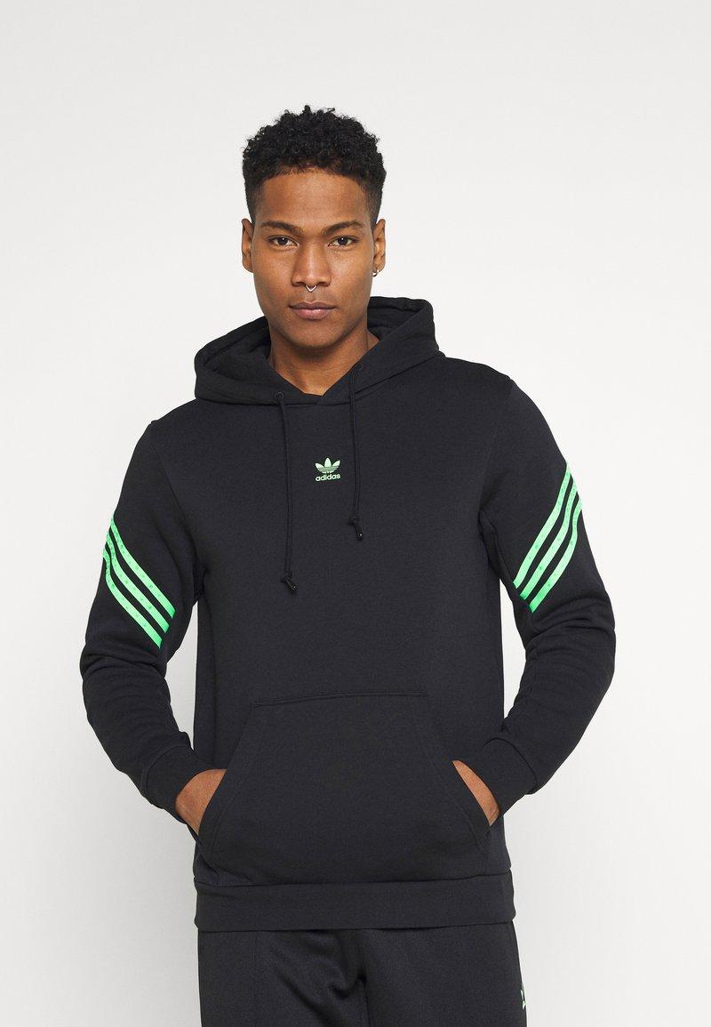 adidas Originals - SWAROVSKI HOODIE UNISEX - Luvtröja - black/shock lime
