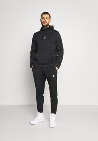 Jordan - AIR PANT - Verryttelyhousut - black/white - 1