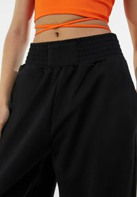 Bershka - Tracksuit bottoms - black - 3