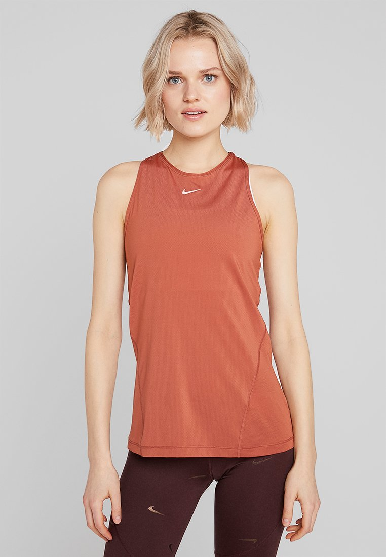 Nike Performance - TANK ALL OVER  - Sports shirt - dusty peach/echo pink