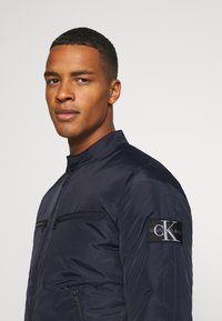 Calvin Klein Jeans - PADDED MOTO JACKET - Light jacket - night sky - 4