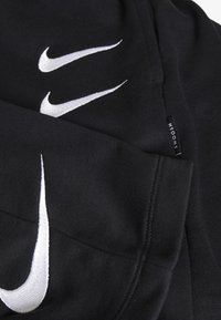 Nike Sportswear - Tracksuit bottoms - black/white - 3