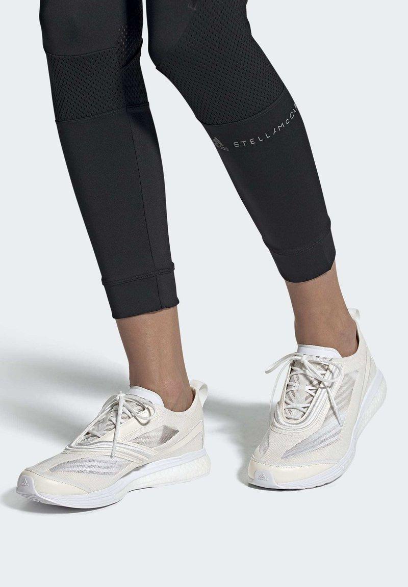 adidas by Stella McCartney - Neutrální běžecké boty - white