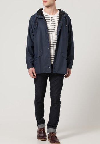 UNISEX JACKET - Waterproof jacket - blue