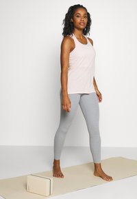 Nike Performance - THE YOGA LUXE - Tights - particle grey - 1