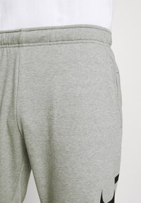 Nike Performance - TAPER - Tracksuit bottoms - dark grey heather/black - 5