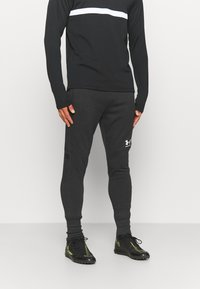 Under Armour - ACCELERATE OFF-PITCH JOGGER - Tracksuit bottoms - black/white - 0