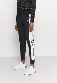 Champion - CUFF PANTS - Pantaloni sportivi - black - 0