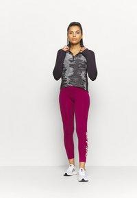 adidas Performance - ZIP - Sports shirt - purple - 1