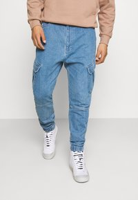 Karl Kani - PANTS - Jeans Tapered Fit - blue - 0