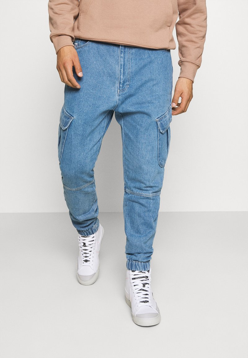 Karl Kani - PANTS - Jeans Tapered Fit - blue